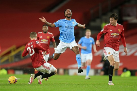 Luke Shaw makes a tackle during Manchester United's defeat to Manchester City