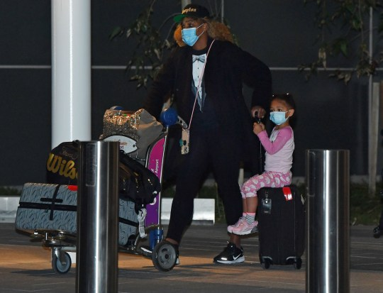 Serena Williams with her daughter Alexis Olympia Ohanian Jr. arrives at Adelaide Airport on January 14, 2021 in Adelaide, Australia. All players and staff arriving in Adelaide for the Australian Open must complete 14 days of hotel quarantine before being able to compete in Adelaide and then to Melbourne for the Australian Open and lead up events. Quarantining players will be able to leave their rooms for up to five hours a day, but only to attend dedicated quarantine training venues. Players will only be permitted to train once their day two COVID-19 comes back negative. All other staff and officials will need to remain in their rooms at all times for the 14 days of quarantine. The 2021 Australian Open will be the largest international sporting event to be held in Australia since the beginning of the coronavirus pandemic.