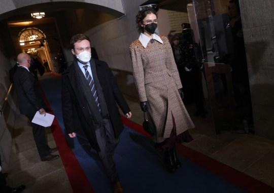 Ella Emhoff and partner walking into the inauguration