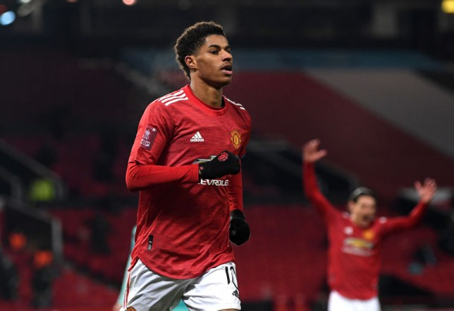Marcus Rashford of Manchester United celebrates after scoring their side's second goal during The Emirates FA Cup Fourth Round match between Manchester United and Liverpool at Old Trafford on January 24, 2021 in Manchester, England. Sporting stadiums around the UK remain under strict restrictions due to the Coronavirus Pandemic as Government social distancing laws prohibit fans inside venues resulting in games being played behind closed doors.