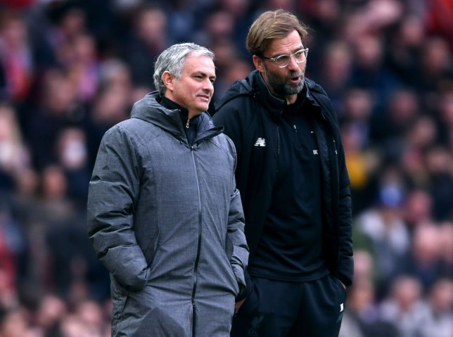 Jose Mourinho, Manager of Manchester United and Jurgen Klopp, Manager of Liverpool speak during the Premier League match between Manchester United and Liverpool at Old Trafford on March 10, 2018 in Manchester, England.