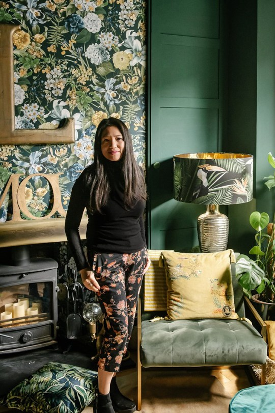 MUM-of-three Lily Sawye has transformed her drab Victorian terrace in Stratford, East London into a colourful wonderland on a budget using brave dark paint colours, patterned wallpaper and ??5 vintage finds. Picture shows: Lily Sawyer front room TRIANGLE NEWS 0203 176 5581 // contact@tringlenews.co.uk Pics By Emily Hall A MUM-of-three has transformed her drab Victorian terrace into a colourful wonderland on a budget using brave dark paint colours, patterned wallpaper and ??5 vintage finds. Lily Sawyer???s dreary three-bed pad was a sea of magnolia when she first moved in with every room painted either white or cream. But then Lily set to work to make her home an Instagram-worthy sensation by picking luscious dark shades - including black - and brightly-coloured floral wallpapers to really make the place pop. Lily and her husband David, a financial director, bought their home in Stratford, East London, for ??445,000 in 2014 and were initially wowed by its original features.