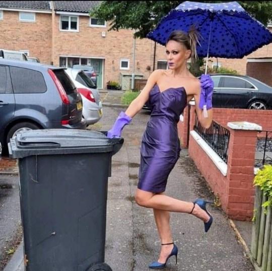 nicola matthews purple dress and umbrella by wheelie bin