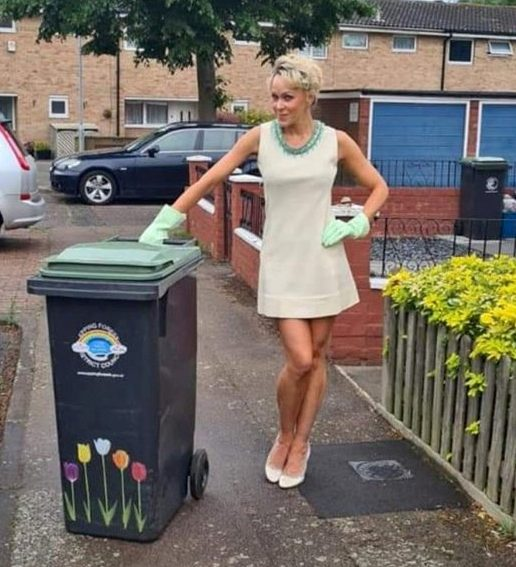 Meet Nicola Matthews, who spent nearly six months donning a different posh frock and heels every week to put her wheelie bin out.