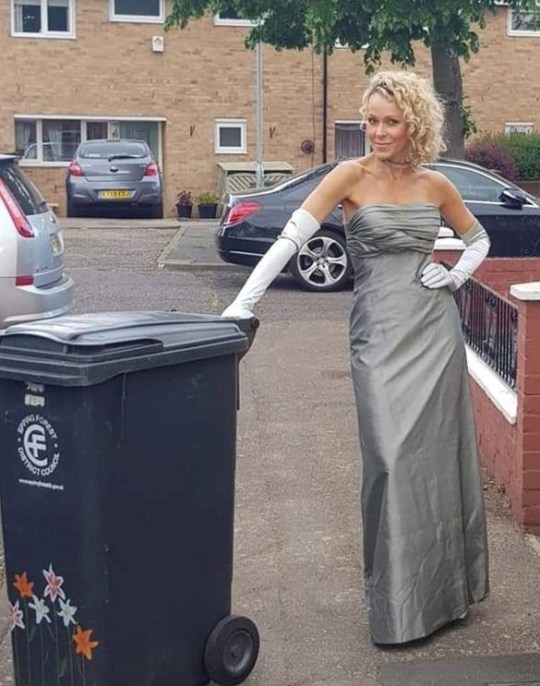nicola matthews wearing a silver gown to take out the bins