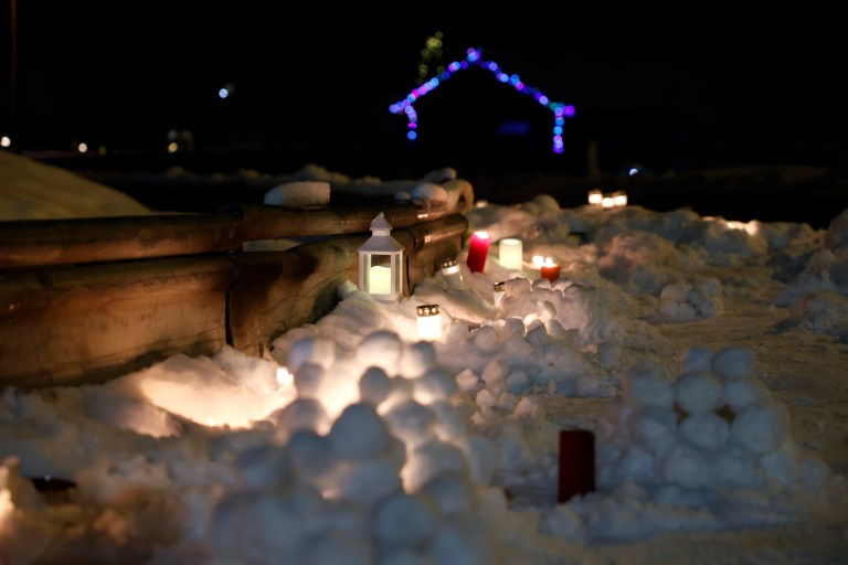 epaselect epa08914722 Candles are placed at the outer edge of the landslide in Ask in Gjerdrum municipality, Norway, 01 January 2021. Several homes have been taken by the avalanche and nine people remain missing after one body was found. More than 1,000 people in the area have been evacuated. EPA/Jil Yngland NORWAY OUT