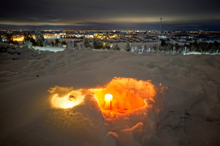 Candle burns for the victims of the deadly landslide that hit a residential area several days ago in Ask, Gjerdrum, Norway January 2, 2021. NTB/Haakon Mosvold Larsen via REUTERS ATTENTION EDITORS - THIS IMAGE WAS PROVIDED BY A THIRD PARTY. NORWAY OUT. NO COMMERCIAL OR EDITORIAL SALES IN NORWAY.