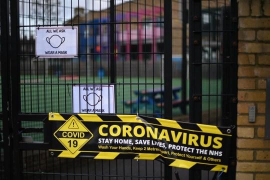 a coronavirus sign on school gates