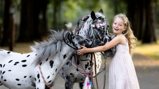 Human Horse Academy / CATERS NEWS (PICTURED Jolie Lune Arends, 7. Kootwijkerbroek, The Netherlands ) - Meet the horse, dog and pony who are all the best of friends and look IDENTICAL - despite them not even being the same species. Horse trainer Greetje Arends-Hakvoort has three identical looking pets - one Appaloosa stallion, one Shetland pony and one Dalmatian dog - all of which showcase their stunning black spots. Despite their size differences, the three animals love to play together, with owner Greetje regularly catching them running, training, and having fun together. Mum Greetje, 35, loves taking the animals out with her seven-year-old daughter Jolie Lune Arends, who loves riding the Shetland pony - to the amazement of passers by. - SEE CATERS COPY