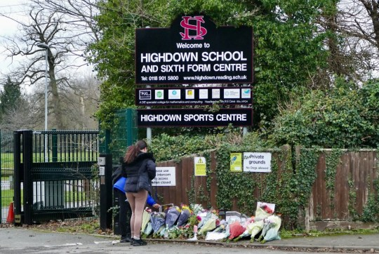 Mandatory Credit: Photo by Geoff Swaine/REX (11679924e) Oliver Stephens friends leave tributes and read the messages left outside Highdown School Floral tributes to murdered teen Oliver 'Olly' Stephens, Emmer Green, Berkshire, UK - 05 Jan 2021