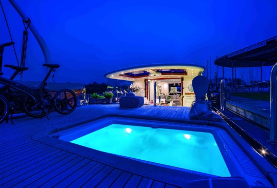 hot tub on deck of posh houseboat for sale