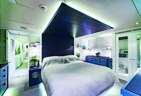 main bedroom in luxury houseboat for sale