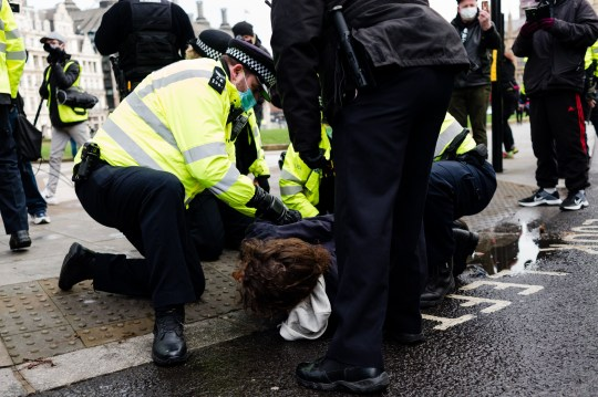 Police officers arrest a protestor during an anti-COVID-19 lockdown demonstration outside the Houses of Parliament in Westminster in London, Britain, 6 January 2021. England has enter its toughest nationwide lockdown since March to help stem the tide of rising coronavirus disease (COVID-19) cases across the country. British Prime Minister Boris Johnson announced on 04 January evening that there would be a third national lockdown in England. The regulations, expected to remain in place until the middle of February. (Photo by Maciek Musialek/NurPhoto)