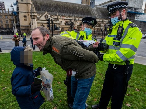 Maskless man 'arrested in front of children at anti-lockdown protest'