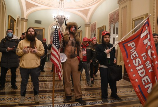 Supporters of US President Donald Trump enter the US Capitol on January 6, 2021, in Washington, DC. - Demonstrators breeched security and entered the Capitol as Congress debated the a 2020 presidential election Electoral Vote Certification. (Photo by MANDEL NGAN / AFP) (Photo by MANDEL NGAN/AFP via Getty Images)