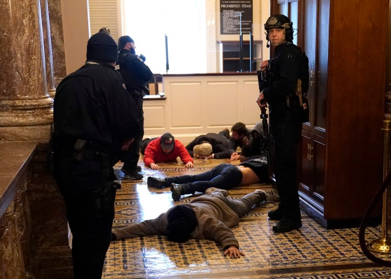 WASHINGTON, DC - JANUARY 06: U.S. Capitol Police stand detain protesters outside of the House Chamber during a joint session of Congress on January 06, 2021 in Washington, DC. Congress held a joint session today to ratify President-elect Joe Biden's 306-232 Electoral College win over President Donald Trump. A group of Republican senators said they would reject the Electoral College votes of several states unless Congress appointed a commission to audit the election results. (Photo by Drew Angerer/Getty Images) Trump/BLM comparison
