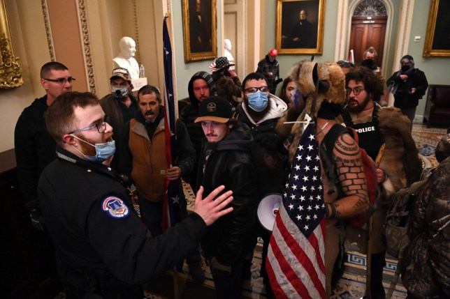 Supporters of US President Donald Trump confront Capitol police officers