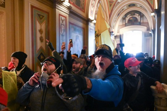 Supporters of US President Donald Trump protest inside the US Capitol on January 6, 2021, in Washington, DC. - Demonstrators breeched security and entered the Capitol as Congress debated the a 2020 presidential election Electoral Vote Certification. (Photo by ROBERTO SCHMIDT / AFP) (Photo by ROBERTO SCHMIDT/AFP via Getty Images)