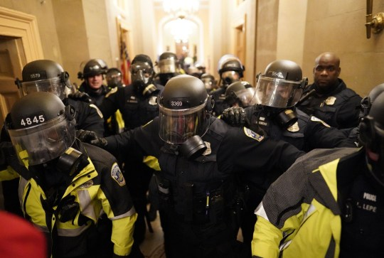 Mandatory Credit: Photo by Kent Nishimura/Los Angeles Times/REX (11695081w) Riot police clear the hallway inside the Capitol on Wednesday, Jan. 6, 2021 in Washington, DC. (Kent Nishimura / Los Angeles Times) Pro-Trump Protests over Electoral College Vote Certification, u.s. Capitol, Washington, Dc, United States - 06 Jan 2021