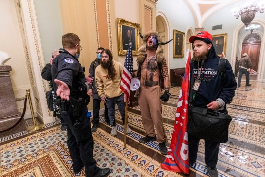 Supporters of President Donald Trump are confronted by Capitol Police officers outside the Senate Chamber inside the Capitol