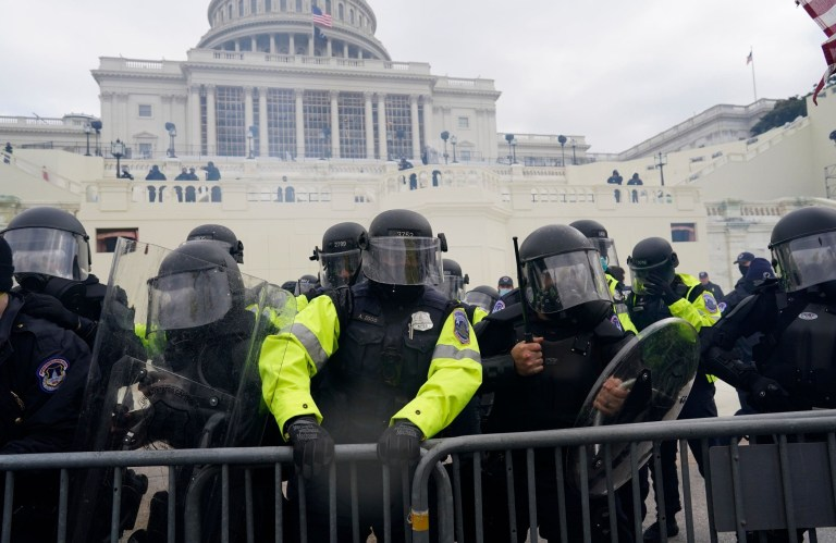 Mandatory Credit: Photo by Kent Nishimura/Los Angeles Times/REX (11695081bk) Police try to hold back protesters who gather storm the Capitol and halt a joint session of the 117th Congress on Wednesday, Jan. 6, 2021 in Washington, DC. (Kent Nishimura / Los Angeles Times) Pro-Trump Protests over Electoral College Vote Certification, u.s. Capitol, Washington, Dc, United States - 06 Jan 2021