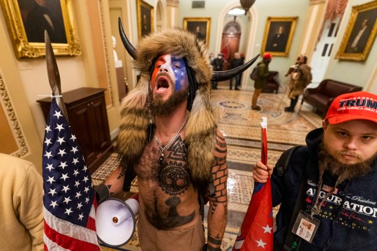 A supporter of President Donald Trump chants outside the Senate Chamber inside the Capitol, Wednesday, Jan. 6, 2021 in Washington. (AP Photo/Manuel Balce Ceneta)
