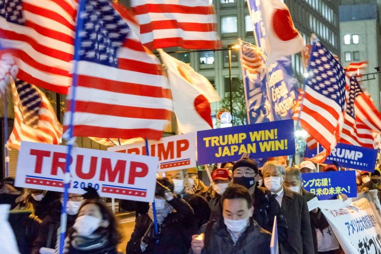 Mandatory Credit: Photo by Damon Coulter/SOPA Images/REX (11695634e) Protesters hold placards and Flags of the United States during the demonstration. The rally of mostly Japanese people took place as part of a similar rally by Trump-supporters in Washington DC as the results of the 2020 US Presidential election were confirmed. Pro-Trump rally in Tokyo, Japan - 06 Jan 2021