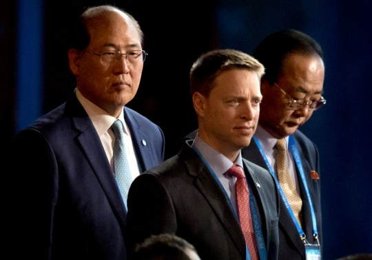 BEIJING, CHINA - MAY 14: Matt Pottinger, Special Assistant to U.S. President Donald Trump and National Security Council (NSC) Senior Director for East Asia, center, and Kim Yong Jae, North Korean minister of external economic relations, right, arrive for the opening ceremony of the Belt and Road Forum at the China National Convention Center (CNCC) in Beijing, Sunday, May 14, 2017. (Photo by Mark Schiefelbein - Pool/Getty Images)