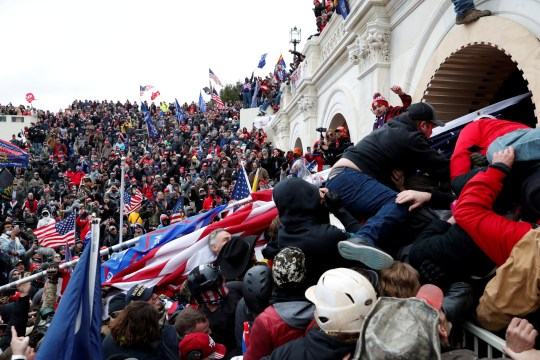 FILE PHOTO: Pro-Trump protesters storm into the U.S. Capitol during clashes with police, during a rally to contest the certification of the 2020 U.S. presidential election results by the U.S. Congress, in Washington, U.S, January 6, 2021. REUTERS/Shannon Stapleton - RC2P2L93TPZS/File Photo