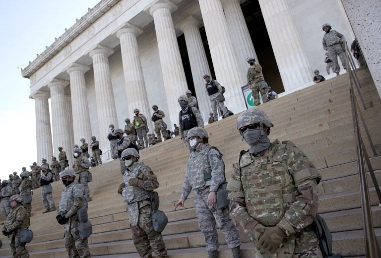 WASHINGTON, DC - JUNE 02: Members of the D.C. National Guard stand on the steps of the Lincoln Memorial as demonstrators participate in a peaceful protest against police brutality and the death of George Floyd, on June 2, 2020 in Washington, DC. Protests continue to be held in cities throughout the country over the death of George Floyd, a black man who was killed in police custody in Minneapolis on May 25.