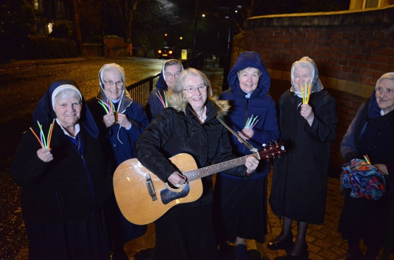 A gathering of nuns sing and clap outside St. Anthony's Convent of Mercy in Sunderland on January 7, 2021 as they take part in the inaugural Clap For Heroes moment of appreciation for all emergency and health workers fighting against the coronavirus pandemic.