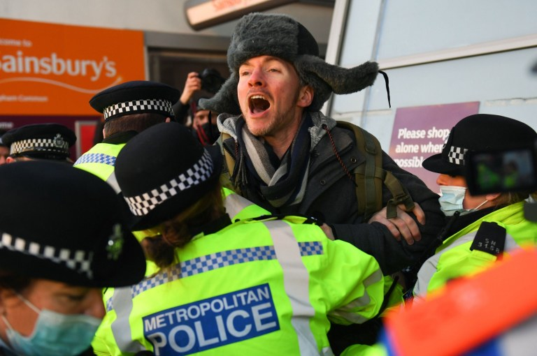 Mandatory Credit: Photo by James Veysey/REX (11701040i) Anti-lockdown protesters clash with police Anti lockdown protest, Clapham Common, London, UK - 09 Jan 2021