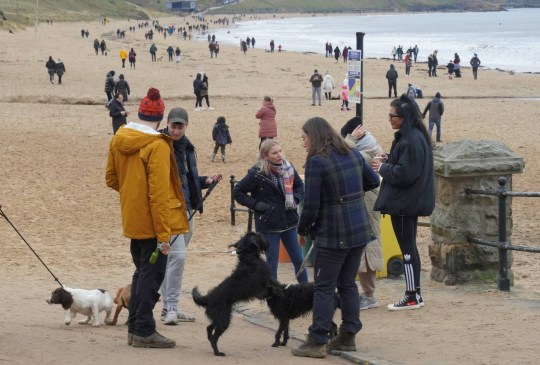 Dated: 10/01/2021 Crowds of people ignore lockdown guidance to stay indoors by enjoying a stoll on Tynemouth Longsands beach in North Tyneside today (SUN) despite the infection rate continuing to rise placing further strain on the NHS.