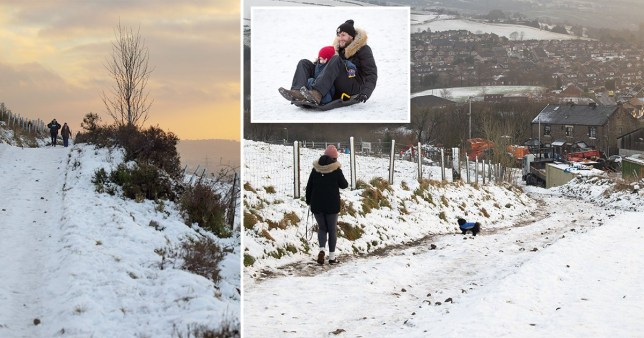 People walking and playing in the snow. The UK is set to be engulfed in snow as temperatures drop and weather experts fear another 'Beast from the East'.