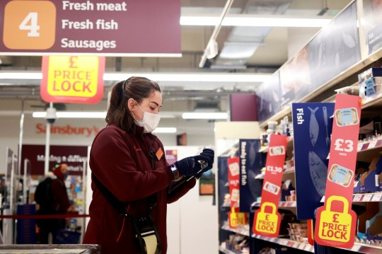A member of staff wearing a face mask works at a Sainsbury's supermarket, amid the spread of the coronavirus disease (COVID-19), in London, Britain January 11, 2021.
