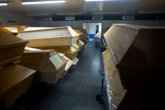 Caskets are stacked with others coffins in the morgue of the crematorium in Meissen, Germany, Monday, Jan. 11, 2021