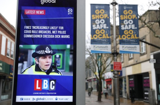 An electronic advertising board displaying latest coronavirus news headlines from LBC on Commercial road in Portsmouth during England's third national lockdown to curb the spread of coronavirus. PA Photo. Picture date: Tuesday January 12, 2021. Under increased measures people can no longer leave their home without a reasonable excuse and schools must shut for most pupils. See PA story HEALTH Coronavirus. Photo credit should read: Andrew Matthews/PA Wire