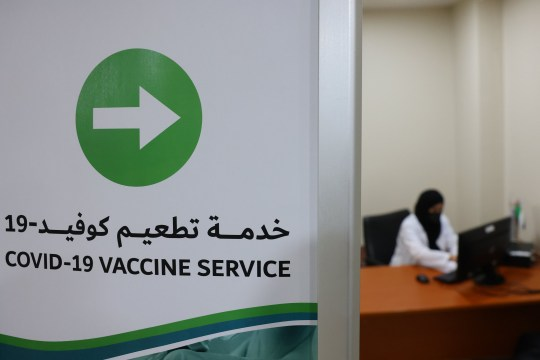 A sign indicates the way to the coronavirus vaccination service at al-Barsha Health Centre in the Gulf Emirate of Dubai on December 24, 2020. (Photo by GIUSEPPE CACACE / AFP) (Photo by GIUSEPPE CACACE/AFP via Getty Images)