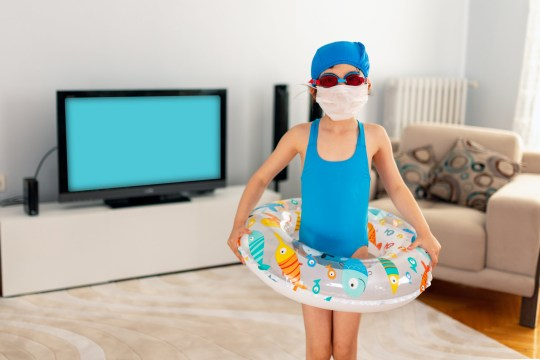 girl with a rubber ring in her living room