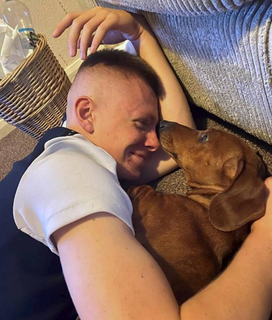 Dated: 13/01/2021 Pernod the sausage dog, who has developed a love of press-ups in lockdown and loves working out with her owner Jake Davie, 15, every day in the front room of the family home in Gateshead. Pictured with Jake. See story and VIDEO by North News