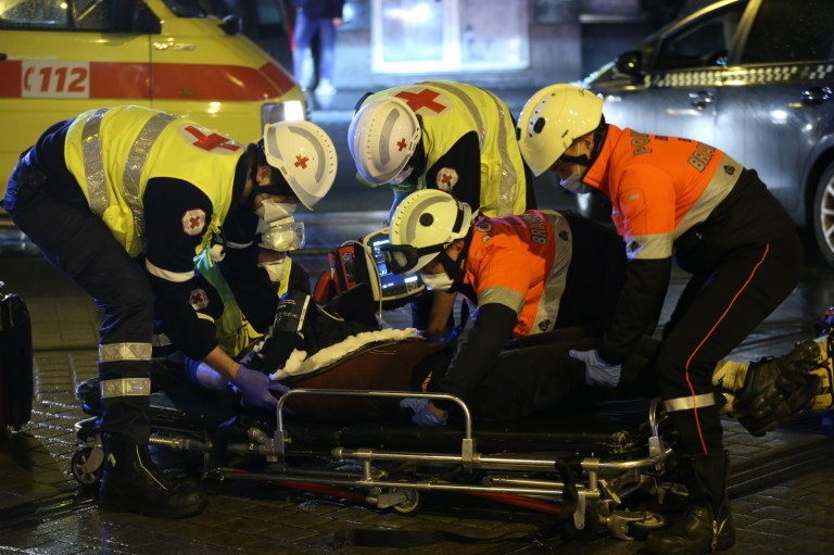 BRUSSELS, BELGIUM - JANUARY 13: Health care workers make first aid following the clash between police and demonstrators as hundreds of demonstrators gather around 'Gare du Nord' during a demonstration after the death of 23-year-old Ibrahima Barrie at the police station, who was detained by the police on the evening of Saturday, January 9 on the grounds that he did not comply with the curfew, in Brussels, Belgium on January 13, 2021. (Photo by Dursun Aydemir/Anadolu Agency via Getty Images)