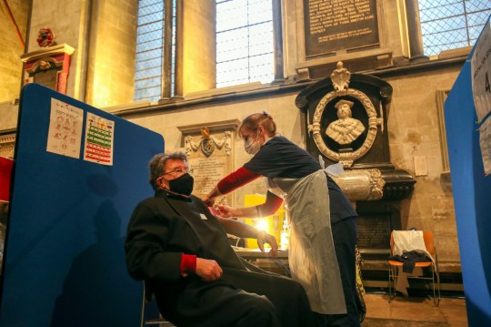 Chaplin Graham Turner receives an injection of the Pfizer coronavirus vaccine at Salisbury Cathedral, Wiltshire. PA Photo. Picture date: Saturday January 16, 2021. The historic site is acting as a venue for the Sarum South Primary Care Network Covid-19 Local Vaccination Service. See PA story HEALTH Coronavirus. Photo credit should read: Steve Parsons/PA Wire