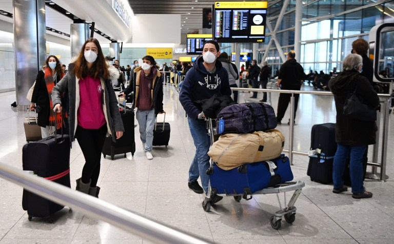 epa08941425 Travellers arrive at Heathrow Airport in London, Britain, 16 January 2021. The UK government is implementing a closure on all travel corridors from Monday 18 January 2021. Travellers will also need to provide a negative coronavirus test to enter the country. Britain's national health service (NHS) is coming under sever pressure as Covid-19 hospital admissions continue to rise across the UK. Some one thousand people are dying each day from the Covid-19 disease. EPA/ANDY RAIN