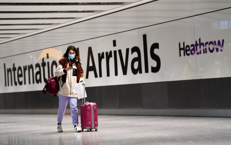 epa08941889 A Traveller arrives at Heathrow Airport in London, Britain, 16 January 2021. The UK government is implementing a closure on all travel corridors from Monday 18 January 2021. Travellers will also need to provide a negative coronavirus test to enter the country. Britain's national health service (NHS) is coming under sever pressure as Covid-19 hospital admissions continue to rise across the UK. Some one thousand people are dying each day from the Covid-19 disease. EPA/ANDY RAIN