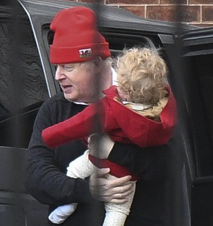 Boris Johnson returns to the back of No10 this morning holding his baby son Wilfred after a walk/jog beleived to be inside Buckingham Palace gardens 17/01/21