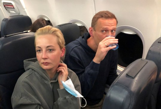 Alexei Navalny and his wife Yulia. Russian authorities arrested Kremlin critic Alexei Navalny as he landed in Moscow.