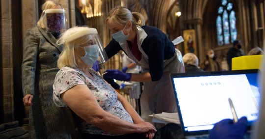 Audrey Elson, 84, receives an injection of the Oxford/AstraZeneca coronavirus vaccine at Lichfield Cathedral, Staffordshire. PA Photo. Picture date: Friday January 15, 2021. See PA story HEALTH Coronavirus. Photo credit should read: Jacob King/PA Wire