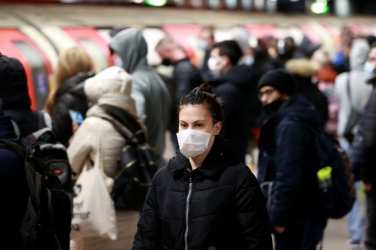 A commuter walks at rush hour, amid the coronavirus disease (COVID-19) outbreak, at Canning Town underground station in London, Britain, January 18, 2021. REUTERS/Hannah McKay