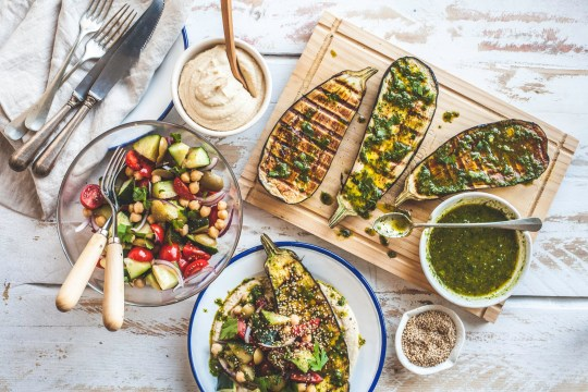 PLANT-BASED DIET - A colourful and fresh spread of grilled eggplant/aubergine with salad, herb butter and mashed butter beans. A balanced and healthy meal for vegans, vegetarians or vegetable lovers!