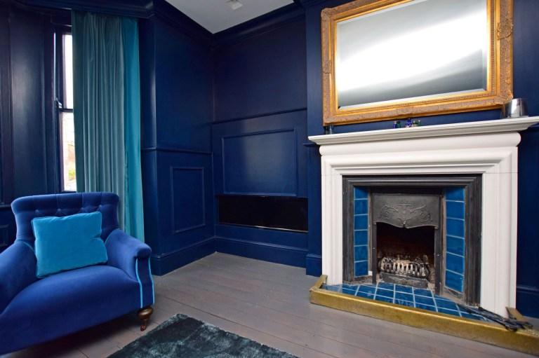 living room in hillside with hidden tv